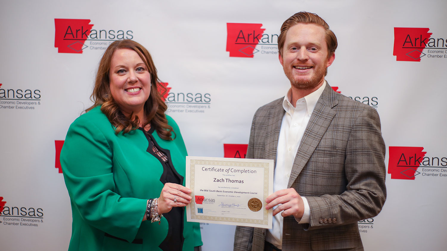 Director of Economic Development Zach Thomas receives his certificate from Shelley Short.